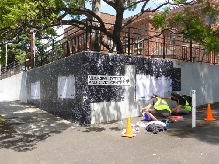 Public artwork being applied to the wall at the front of the Footscray Town Hall
